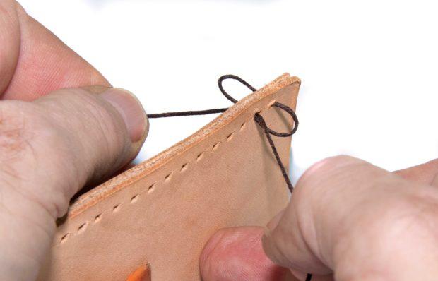 Figure J. Pull the stitch tight.