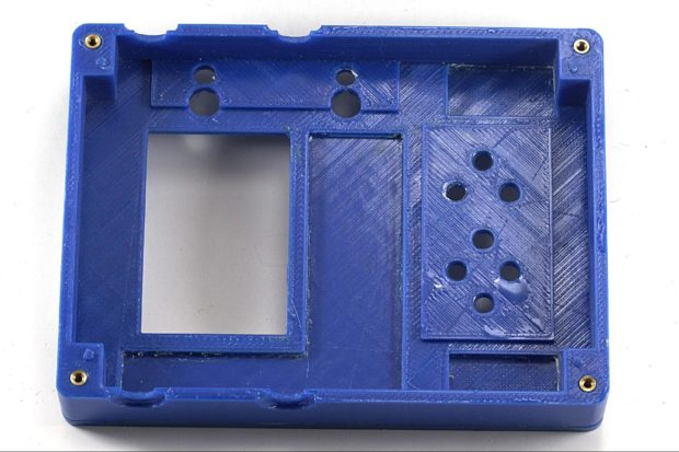 Blue FDM Print open, displaying heat-set brass inserts