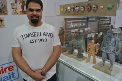 Maitham Abdal shows off his detailed anime sculptures.
