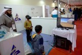 Youngsters testing out the Kuwait 1951 VR simulation.