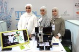 Heba, Fatma, and Fatima, engineers from the American University of Kuwait, show off their Harvesting Robot.