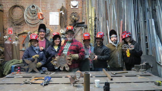 Couples Welding Class: Four happy couples showing off their welding projects.