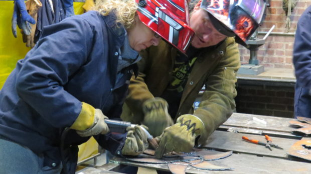 Couples Welding Class: Scott shows a student how to guide the welding torch.