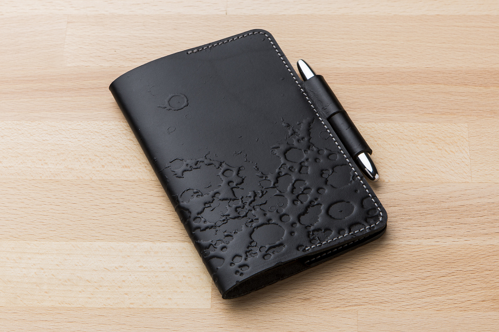 Stamping the Moon's Craters onto a Leather Notebook Cover