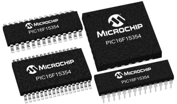 A selection of black PIC micro controllers on a white background