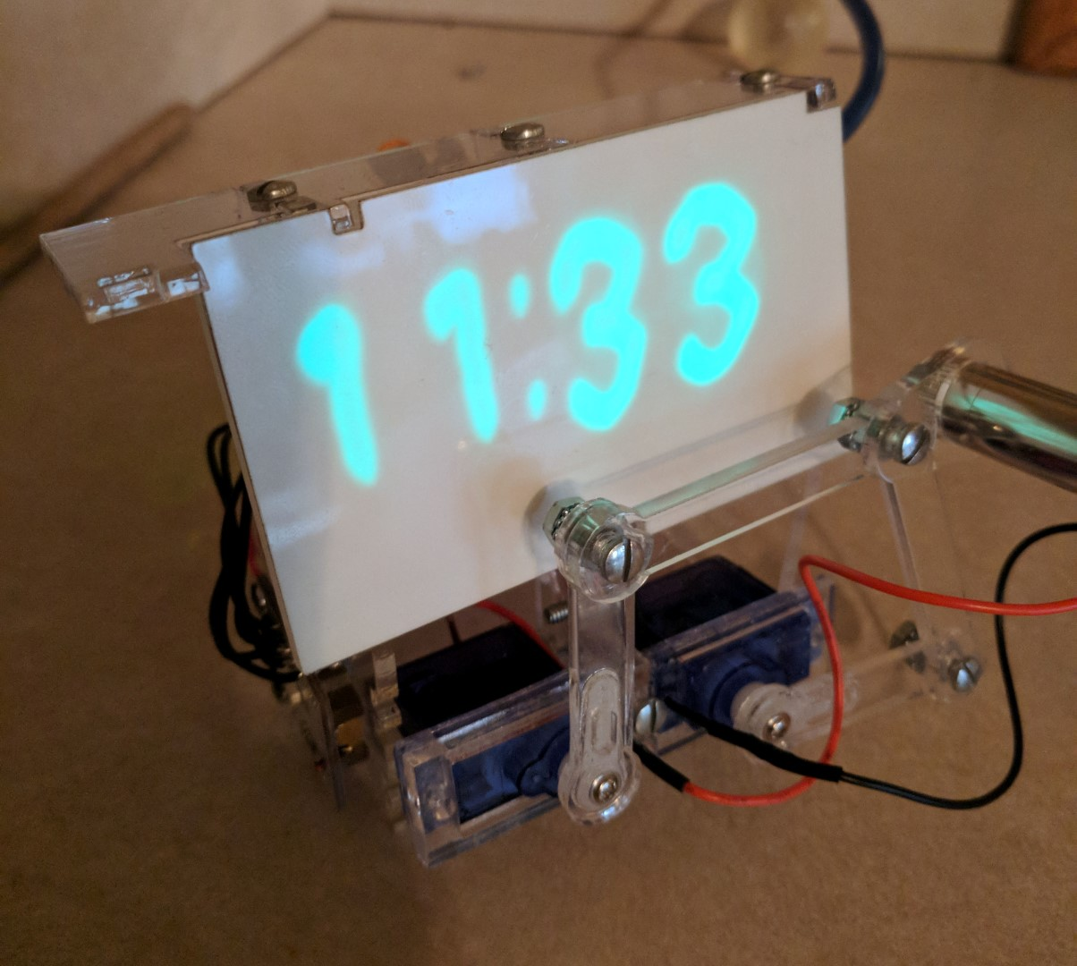 Telling the Time with Robots, Lasers, and Phosphorescence