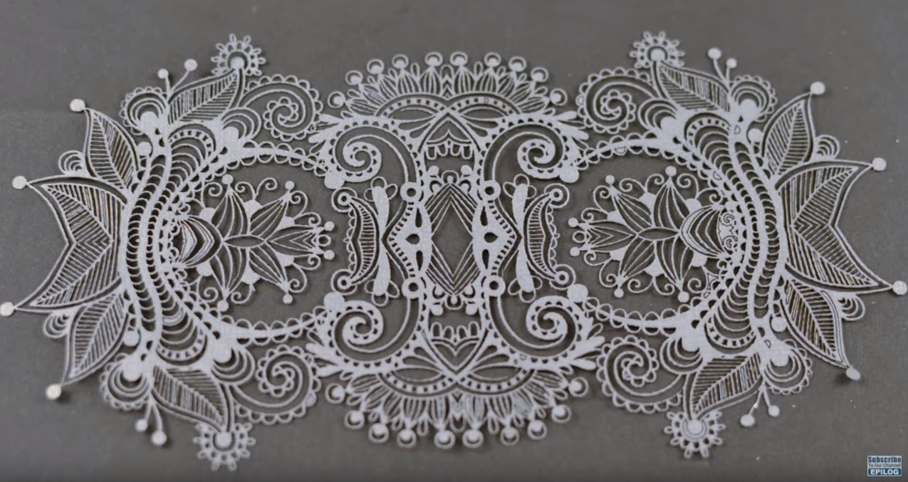 Watch Lasers Cut Intricate Lace Designs From Paper