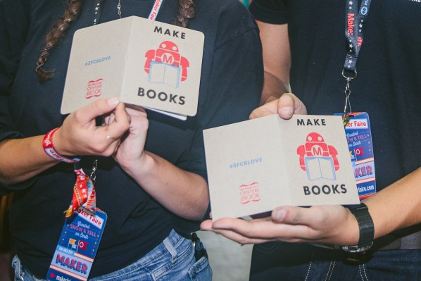 """Two pairs of hands hold two books that both say """"Make Books"""" on the cover."""