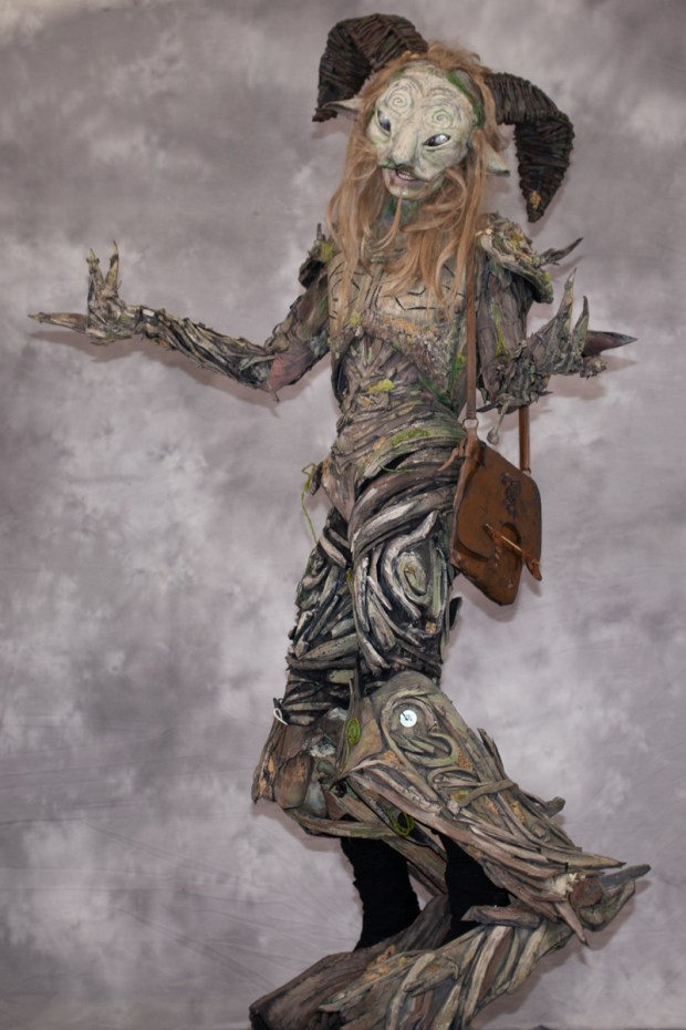 A person dressed as a forest spirit.