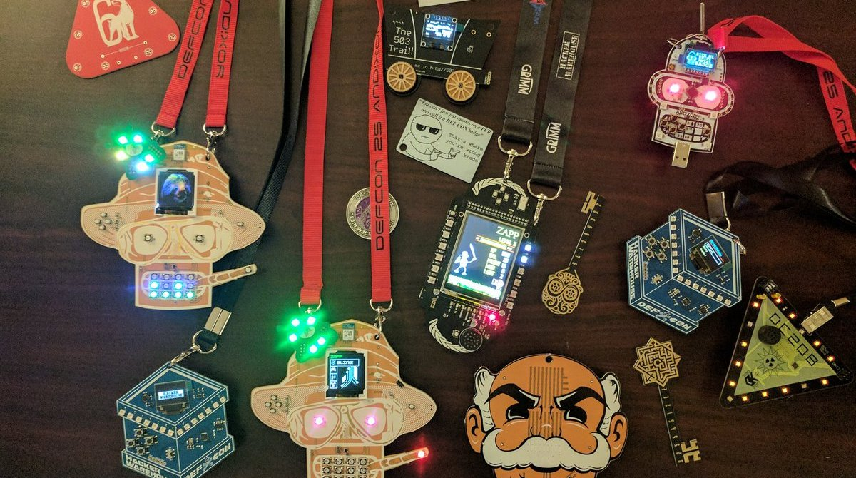 Examples of different badges from hacking conferences.