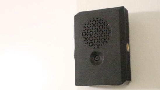 A close up of a speaker Description automatically generated