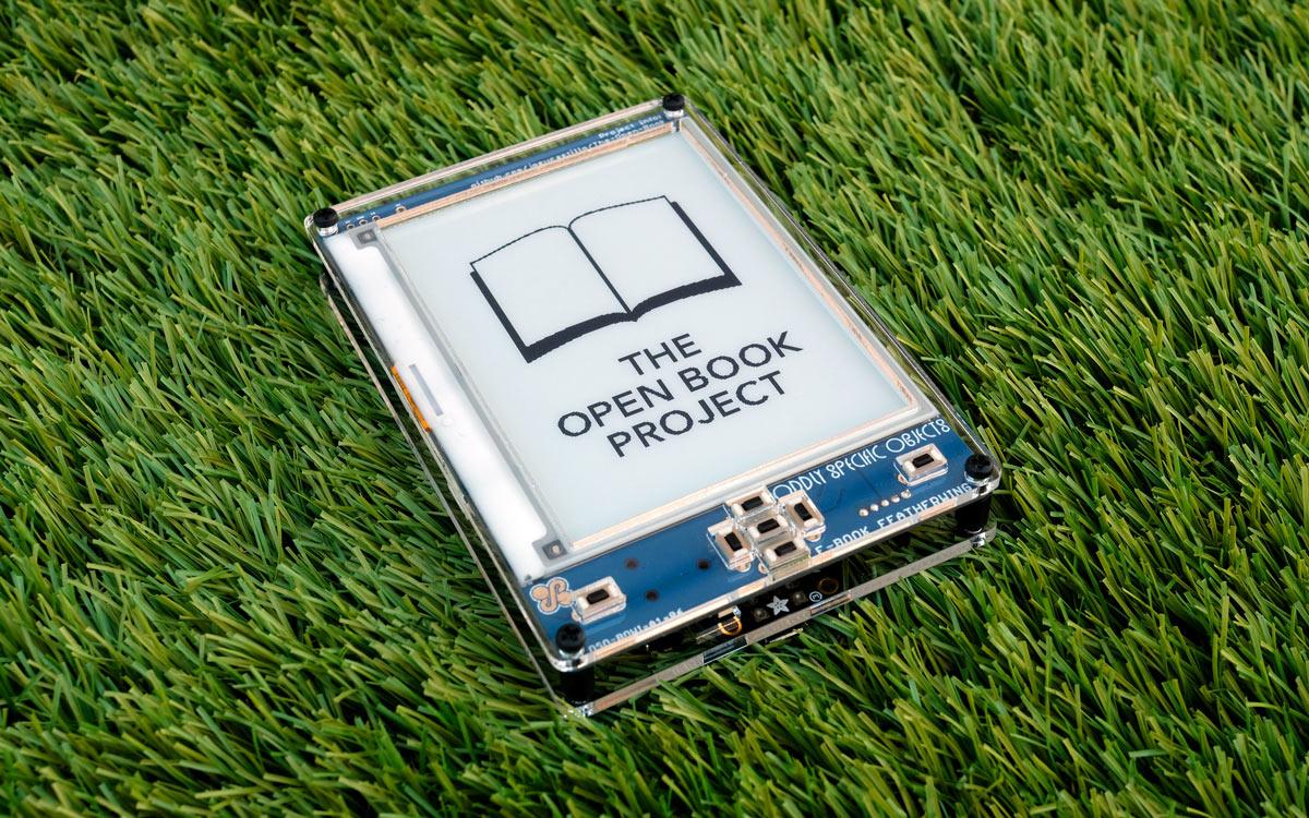 Open Book E-Reader set down on a grassy lawn