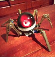 Asi Easy-wear arachnid with LED matrix eye to scare neighbors. Inspired by African spider god Anansi, the trickster/storyteller.