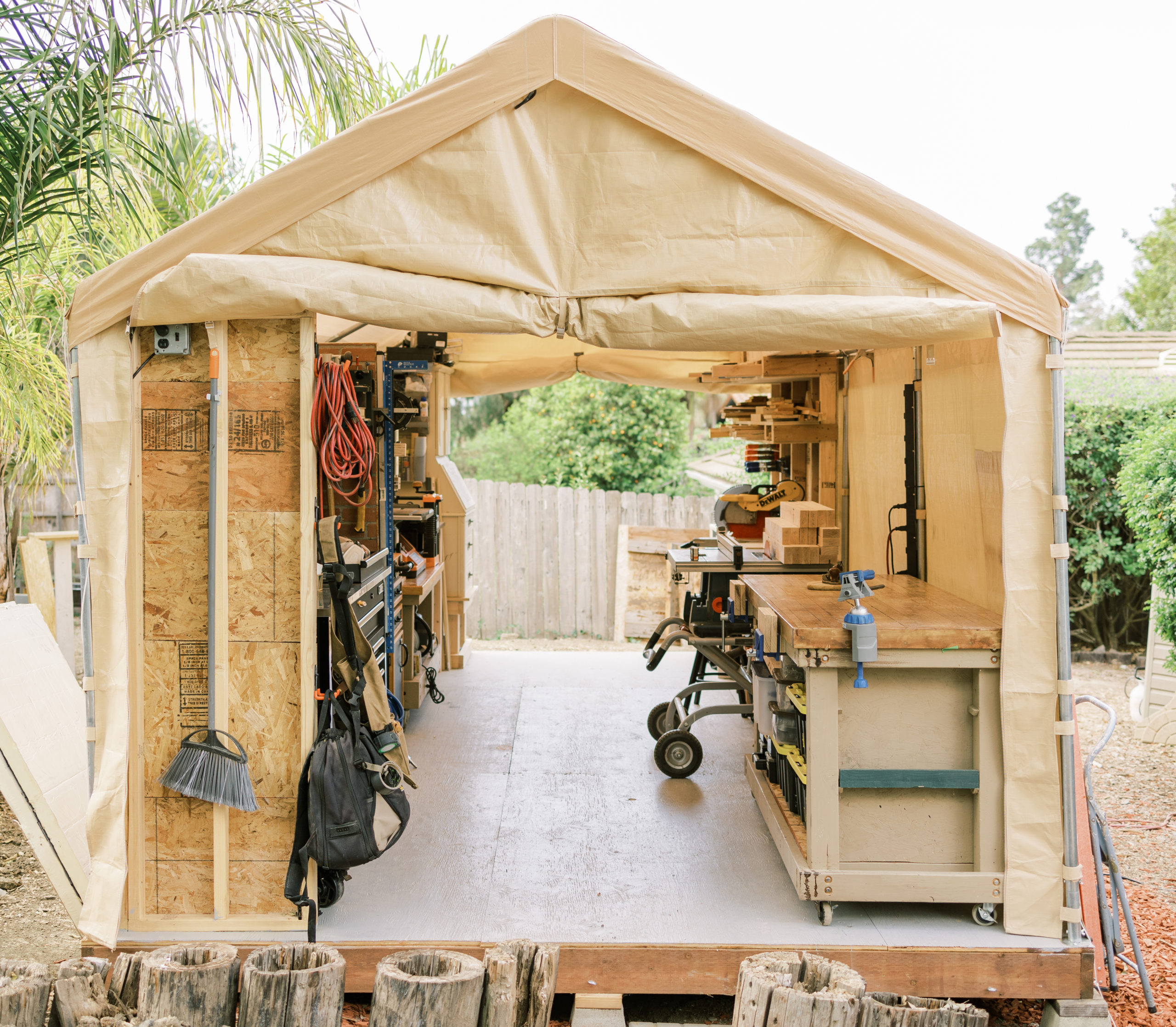 """Shop Tour: This Ingenious """"Temporary"""" Woodshop is Made From a Carport Tent"""