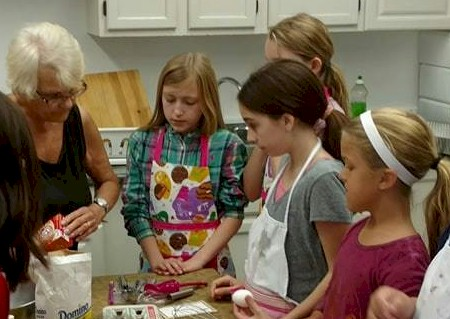 Cadette Girl Scouts Baking Italian Cookies
