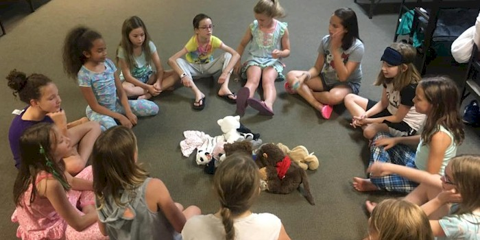 Junior Girl Scouts making friends from other troops.