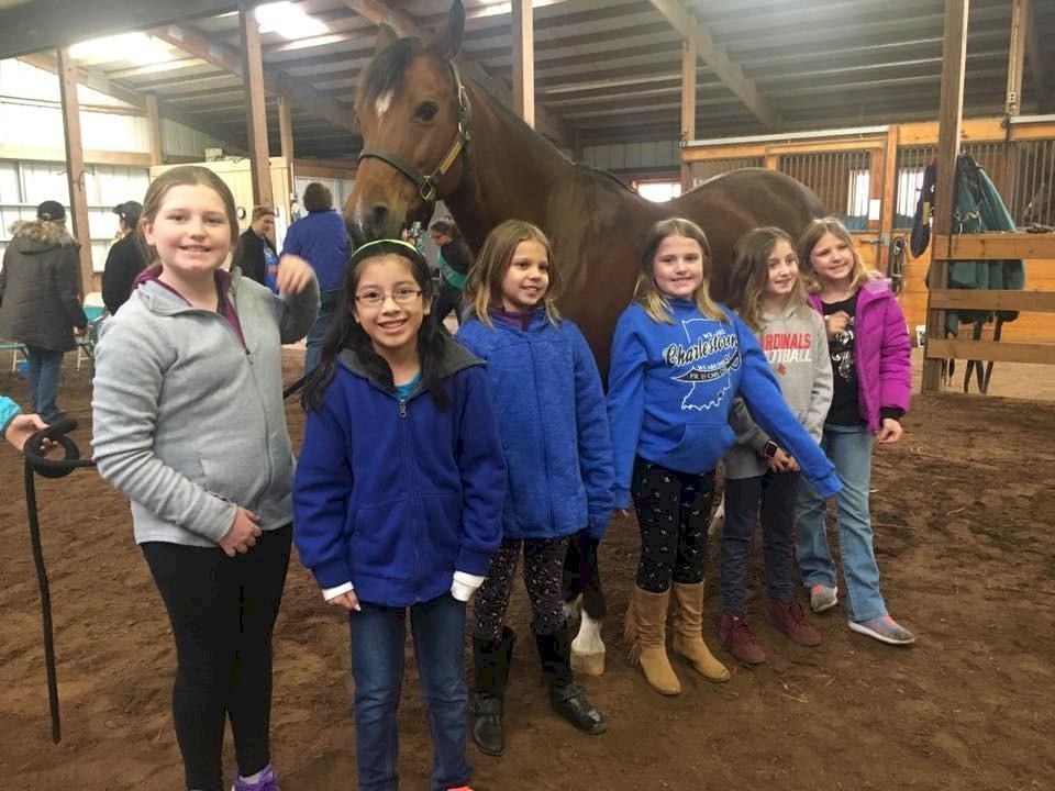 Junior Girl Scouts Horseback Riding.