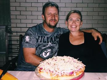 Mum & Dad with their pizza