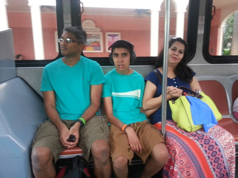 Mysoon and my parents sitting on the bus in the handicap section