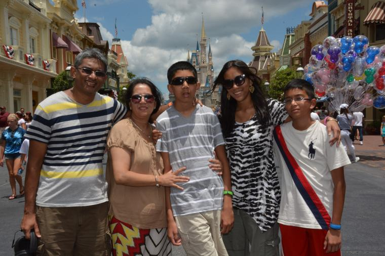 Family picture in front of Cinderella's Castle