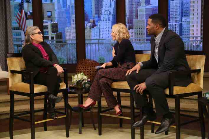 """Kelly Ripa and Michael Strahan talk with Carrie Fisher during the production of """"LIVE with Kelly and Michael"""" in New York on Thursday, Dec. 3, 2015. Photo: David M. Russell/Disney ABC Home Entertainment and Television Distribution ©2015 Disney ABC. All Rights Reserved."""