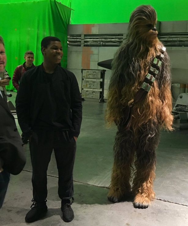 John-Boyega-at-the-Pinewood-Studios-to-meet-Harry-and-William-as-they-tour-the-Star-Wars-set