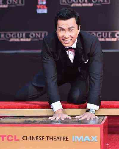 Exclusive pics and video! Star Wars Rogue One's Donnie Yen honored at TCL Chinese Theatre ceremony
