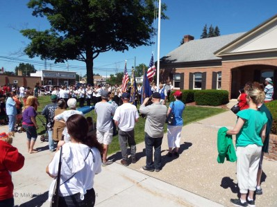 raising and lowering the flag, then Taps.