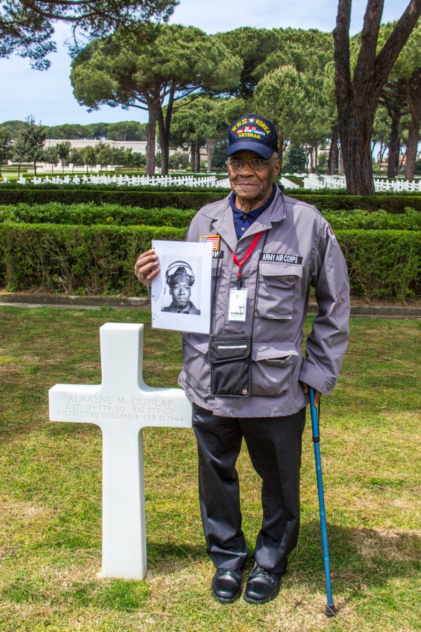 WWII Veteran Thomas Bristow stands next to 2nd Lt. Alwayne M. Dunlop's grave. Dunlap and Bristow were a part of the famed Tuskegee Airmen (332nd Fighter Group), which was an all-African-American fighter group. photo courtesy of of http://www.abmc.gov