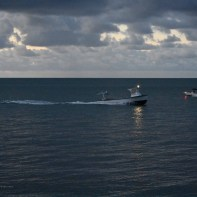 7:02 - the lobster boat coming in and another boat headed out for the morning