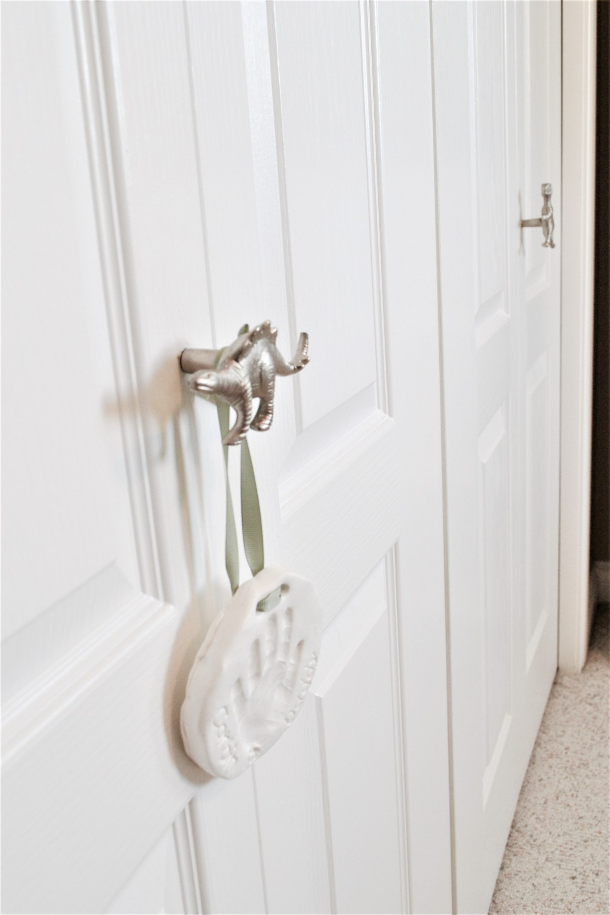 How to decorate your kids room with silver accents - dino closet knobs
