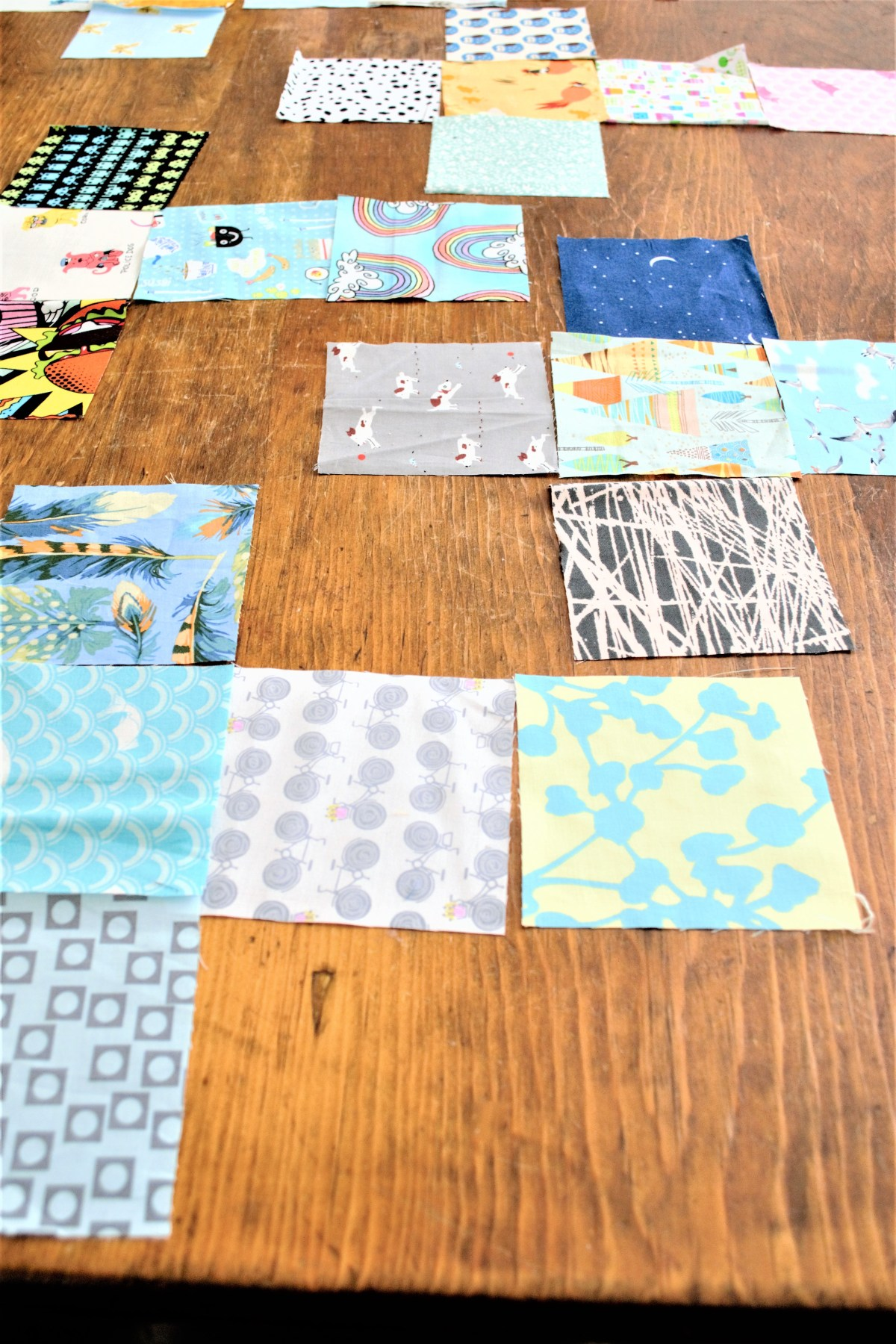 How to Sew Baby Blocks With Taggies! - laying out the squares