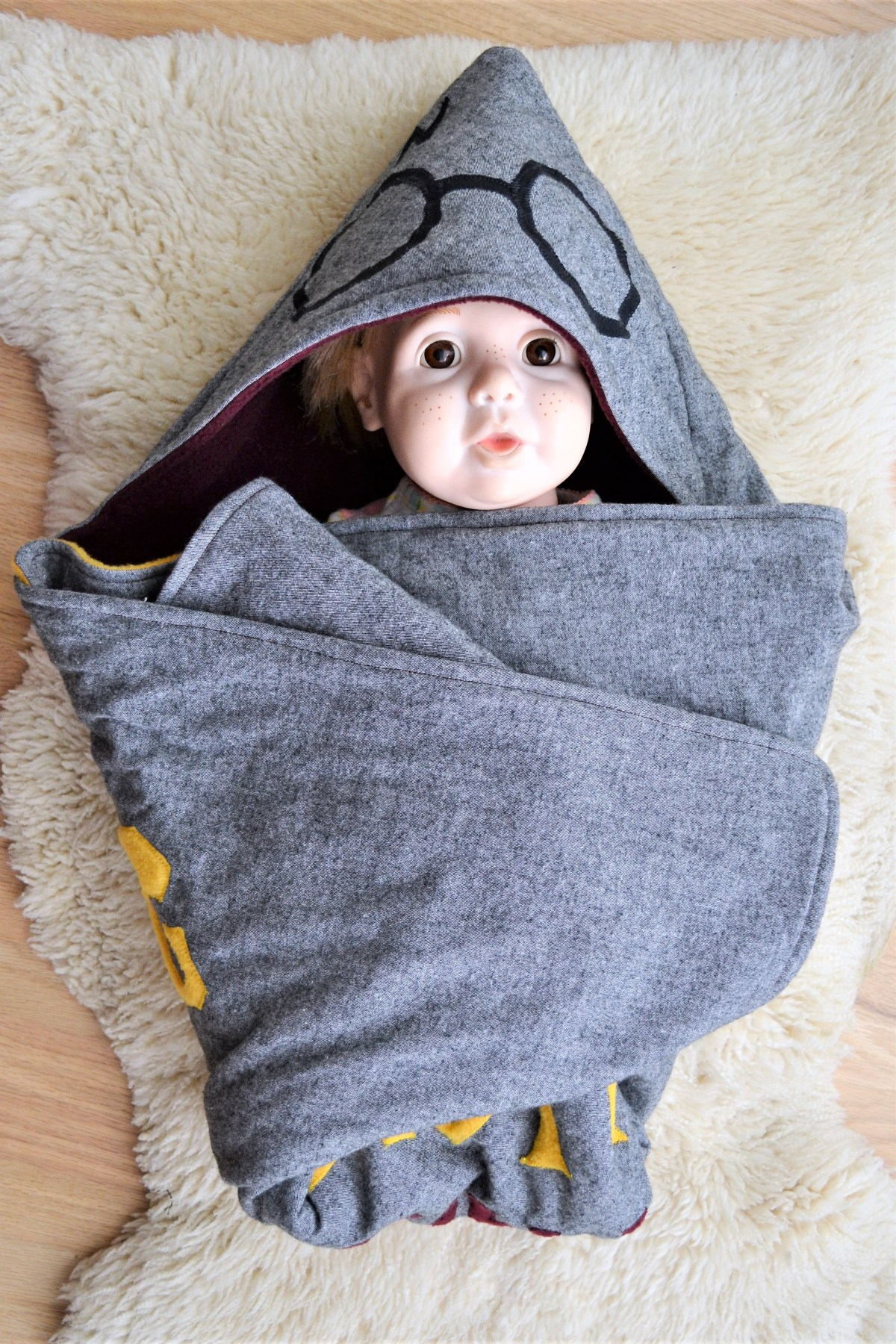 How to Make a Reversible Hooded Baby Blanket - baby model