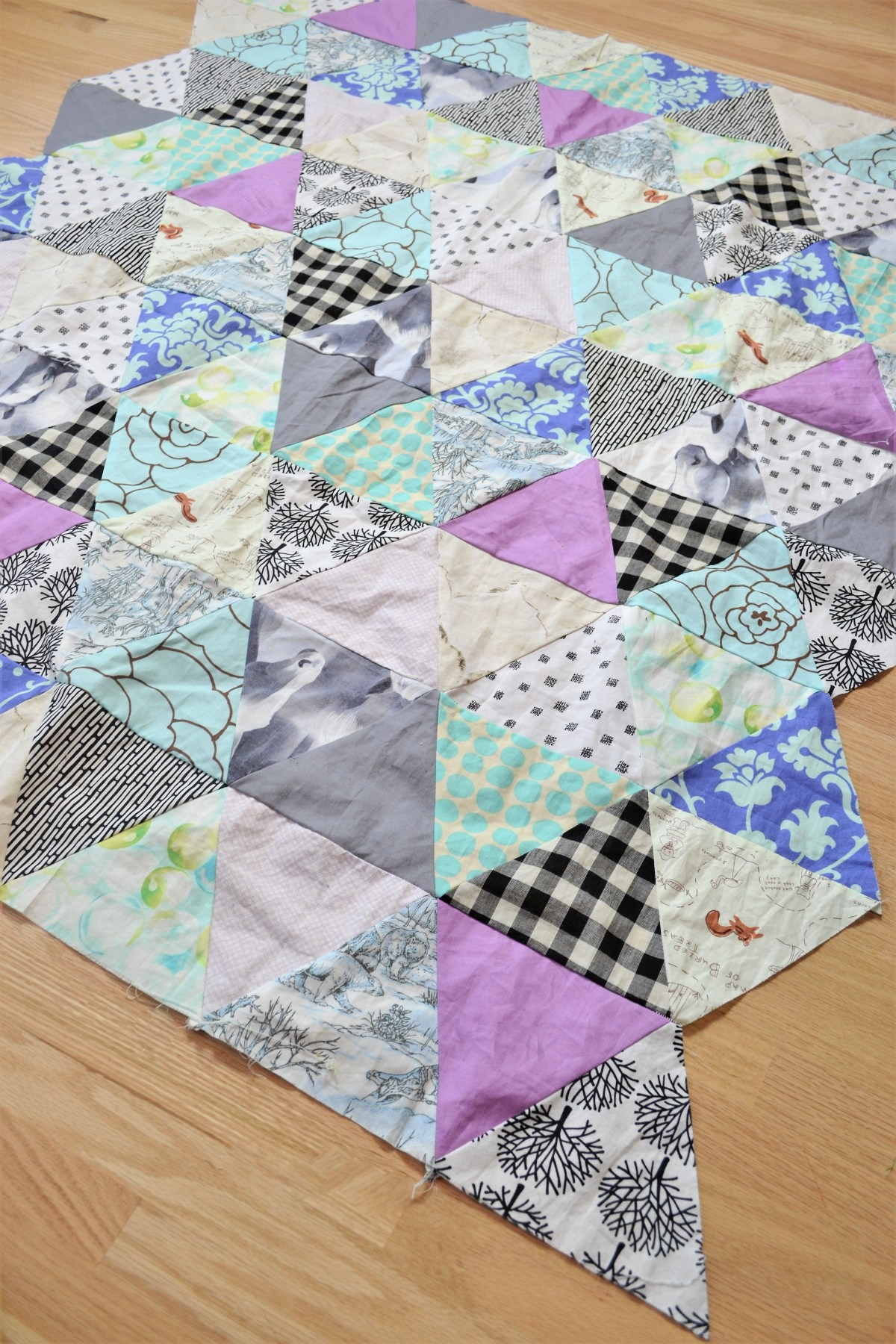 Baby quilt patterns triangle modern quilt pattern for Modern house quilts