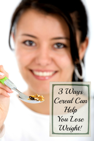girl eating healthy cereal with a spoon isolated over a white background