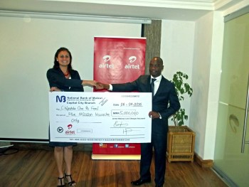 Village Reach Country Director Carla Blauvelt with Airtel MD Charles Kamoto