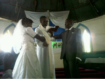 A Pastor blessing a new couple