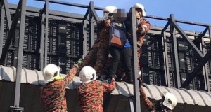 A woman tries to kill herself by jumping off the rooftop of the Jalan Maharajalela Monorail Station pedestrian bridge's rooftop. PIX: Fire and Rescue Department commit suicide
