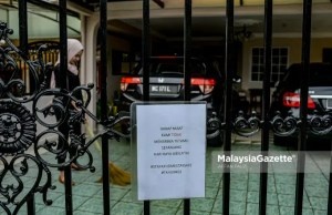 social media Raya posts police PDRM SOP A 'Not Receiving Visitors' notice is put up in front of a house at Wangsa Maju, Kuala Lumpur during the Aidilfitri celebration after the government imposed the Movement Control Order 3.0 (MCO 3.0) to curb the spread of Covid-19 in the country. PIX: AFFAN FAUZI / MalaysiaGazette / 12 MAY 2021.