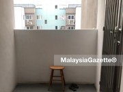 The stool and slippers left behind by the woman who jumped off the 13th floor of Pangsapuri Hijau Indah in Mak Mandin, Penang.