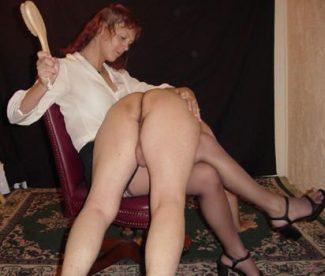 woman calmly spanking a man
