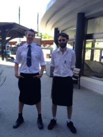 Swedish train drivers Martin Akersten and Edward Elvefors pose wearing a skirt at work. Stockholm, 2013.