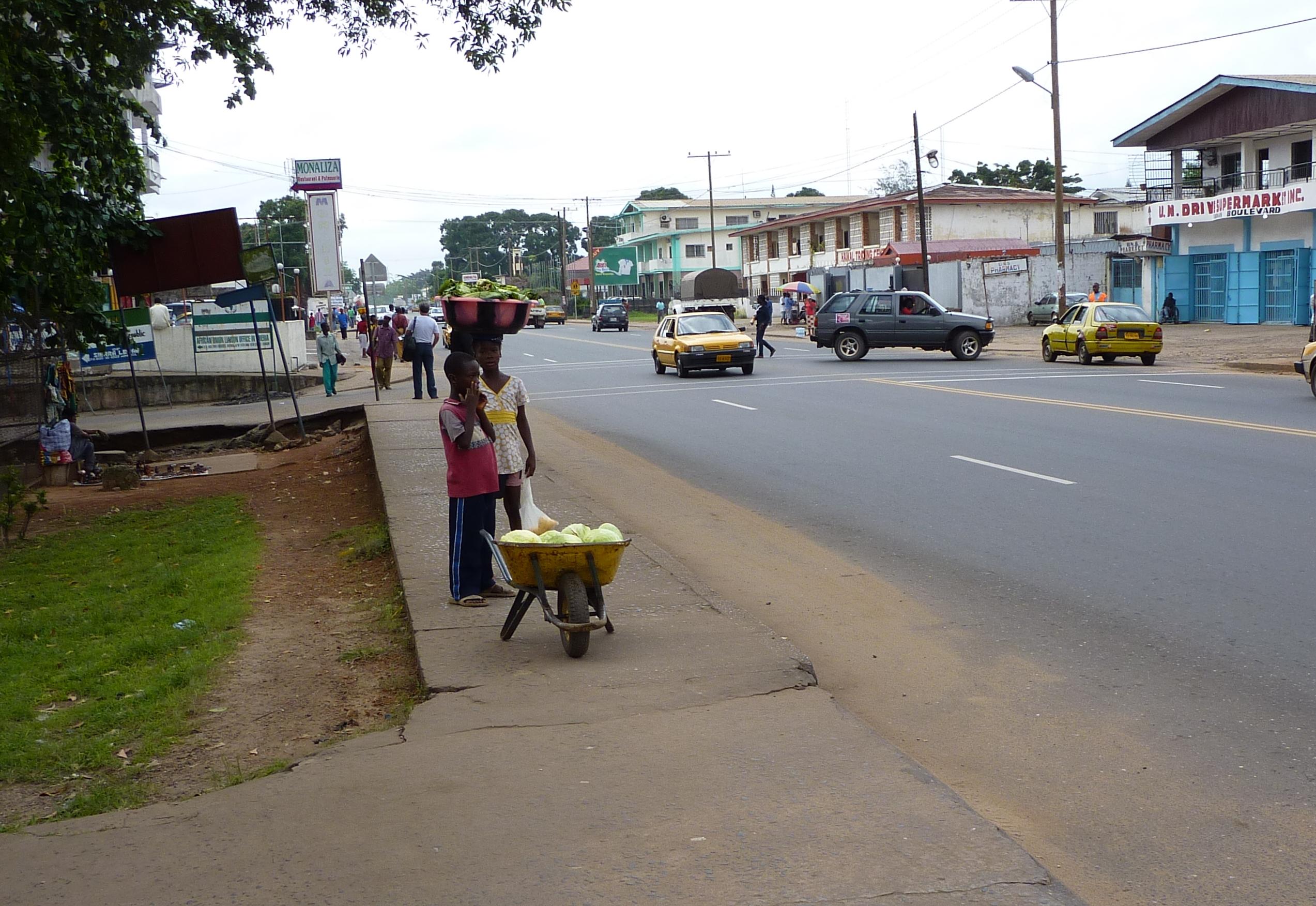 Liberian Boy and Girl Selling Lettuce