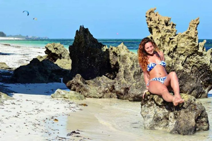 rocking a bikini while in malindi kenya on the rocks - How to look Good in a Bikini