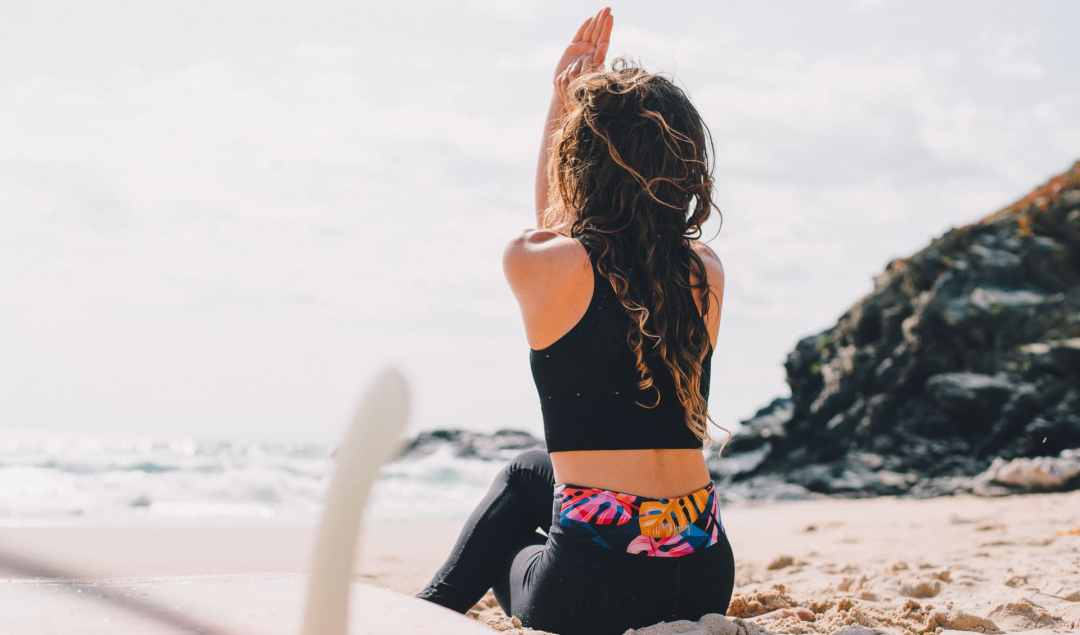 Surf yoga workshop ocean girl eagle arms