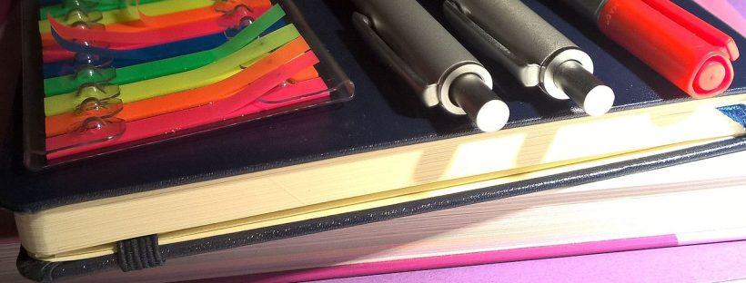 notebooks, pens, sticky notes