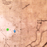 An aged map. Boundaries and streets are faintly outlined in black. A green circle and three blue pinpoints have been superimposed on the map.