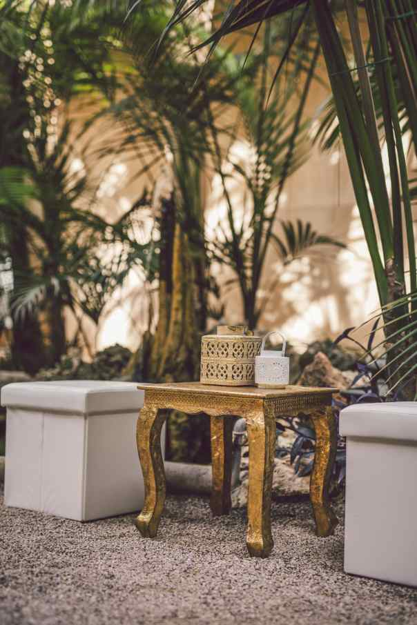 Padded white cubes with ornate gold table