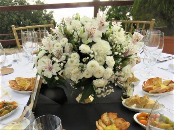 White and blush table arrangements in a gold glass goblet