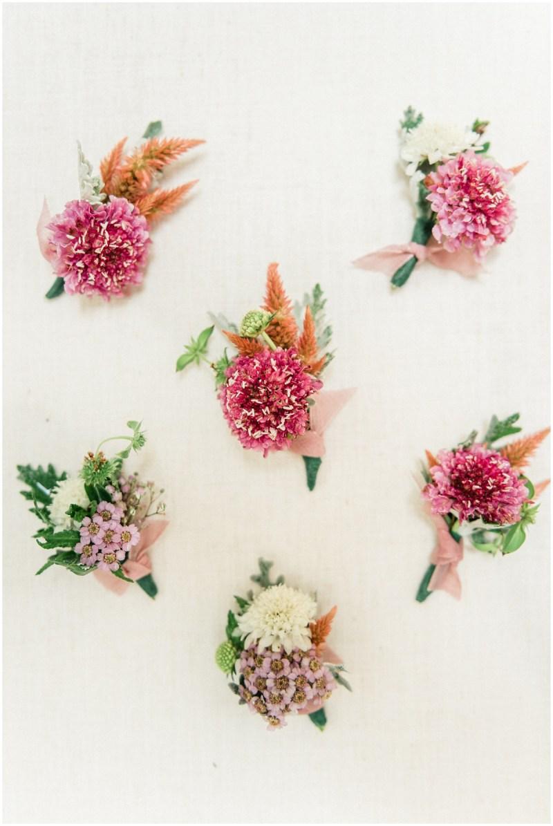 Pink boutonnière wedding inspiration